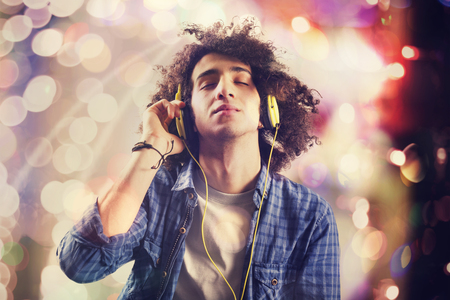 54897878 – young man listening music with headphones